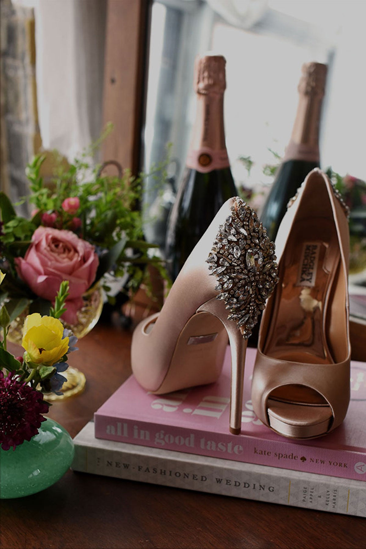wedding shoes and champagne bottle