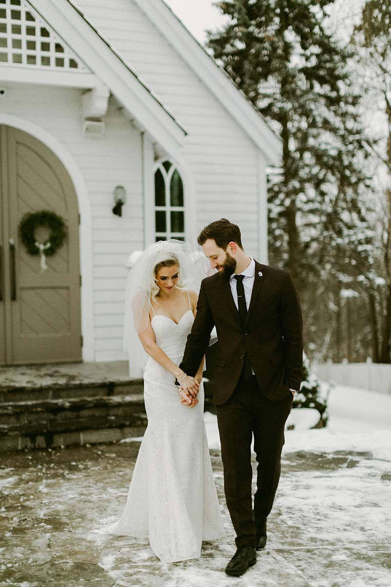 happy bride and groom outdoors at a winter wedding