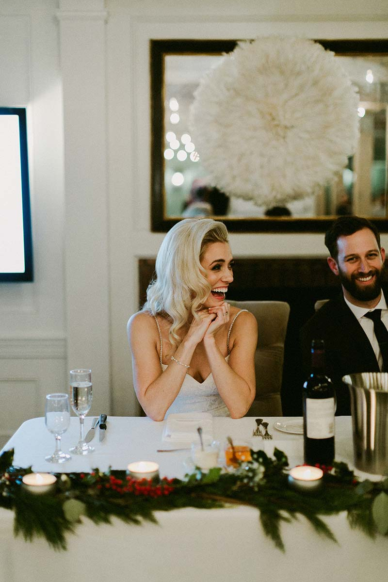 happy bride and groom sitting at the table