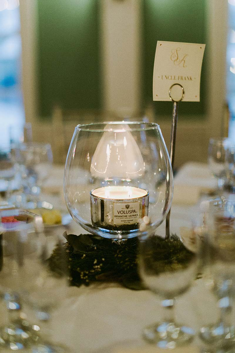 festive candle at the wedding table