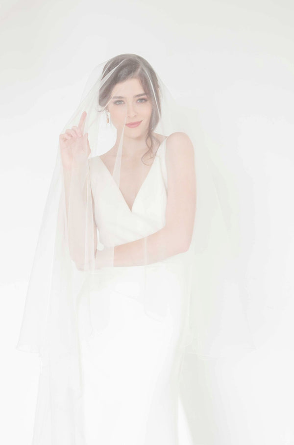 Simple clean minimalist ivory tulle two tired circle cut veil handmade in Canada.