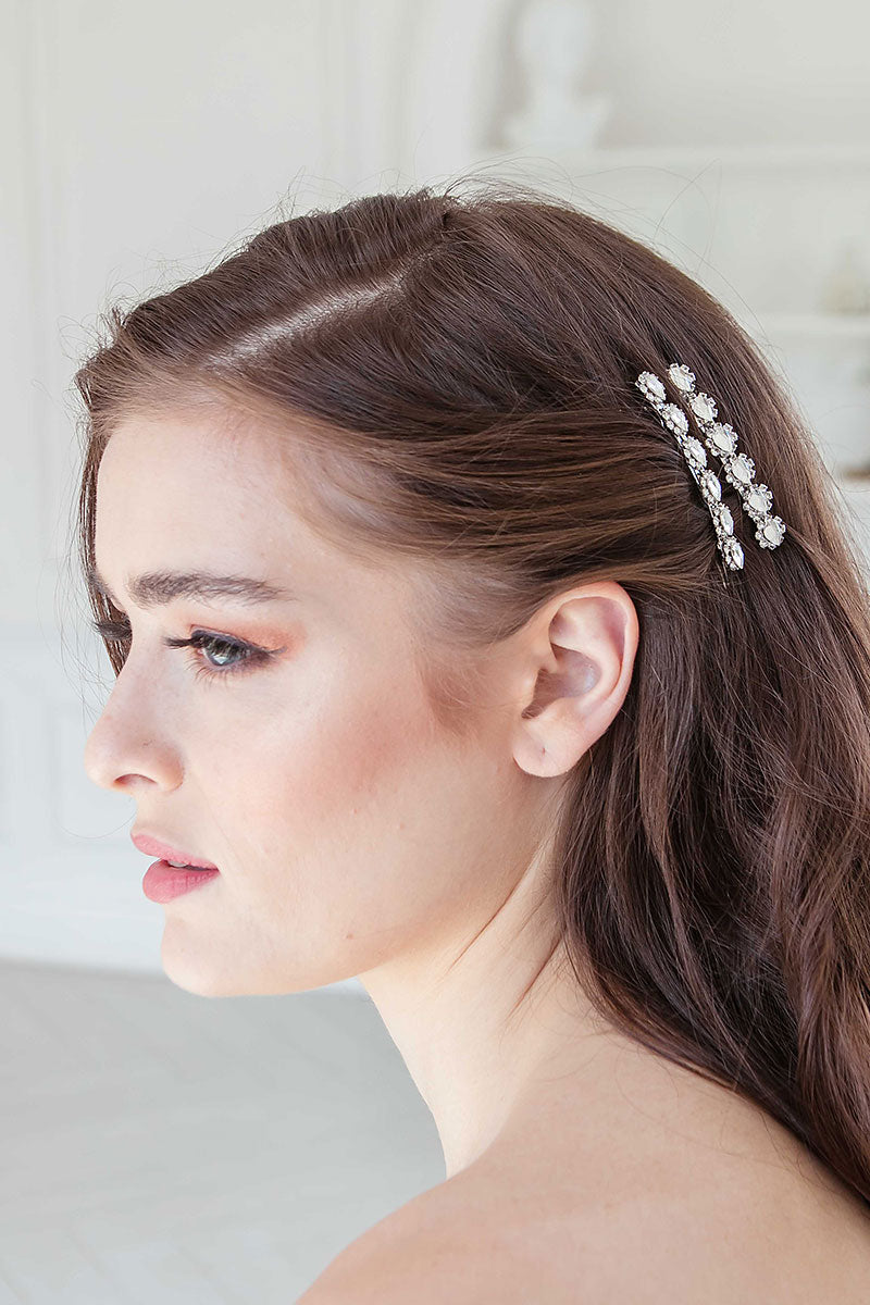 Profile of woman wearing crystal pear jewel barrettes