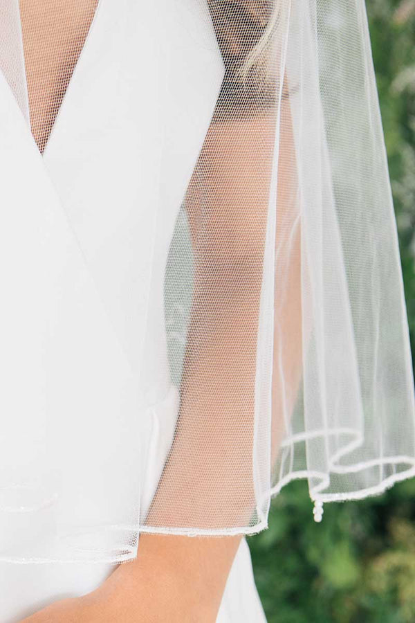 Detail close up of Laura Jayne Jess Beaded Edge Fingertip Bridal Veil