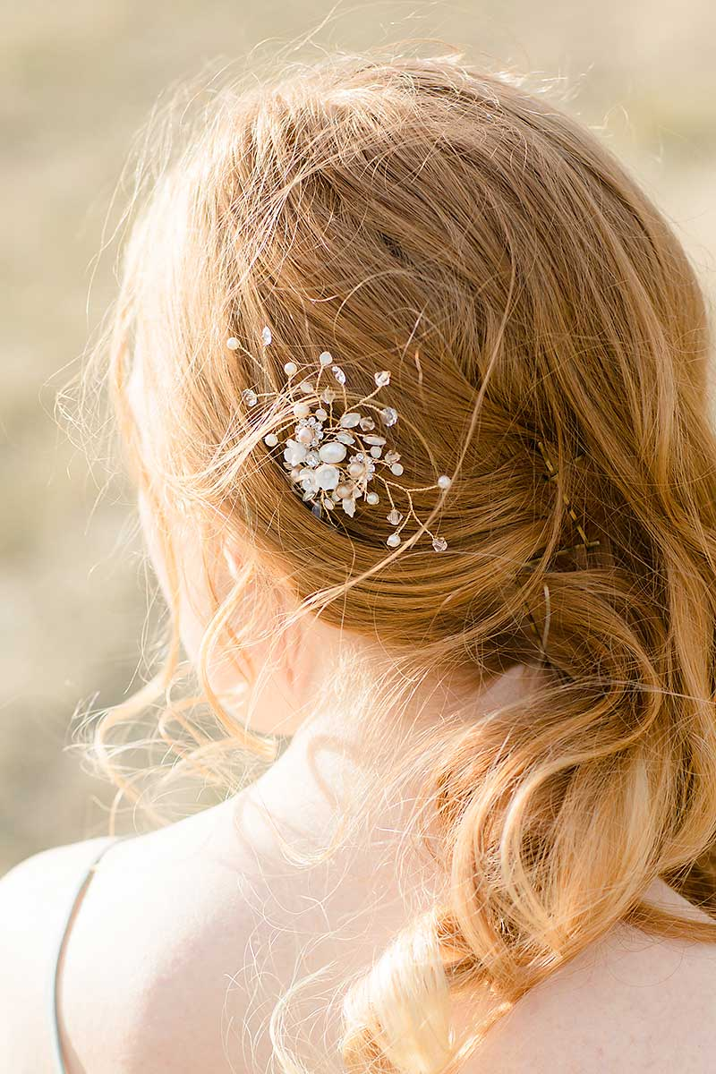 back of woman's head with Laura Jayne Louise gold wired floral comb