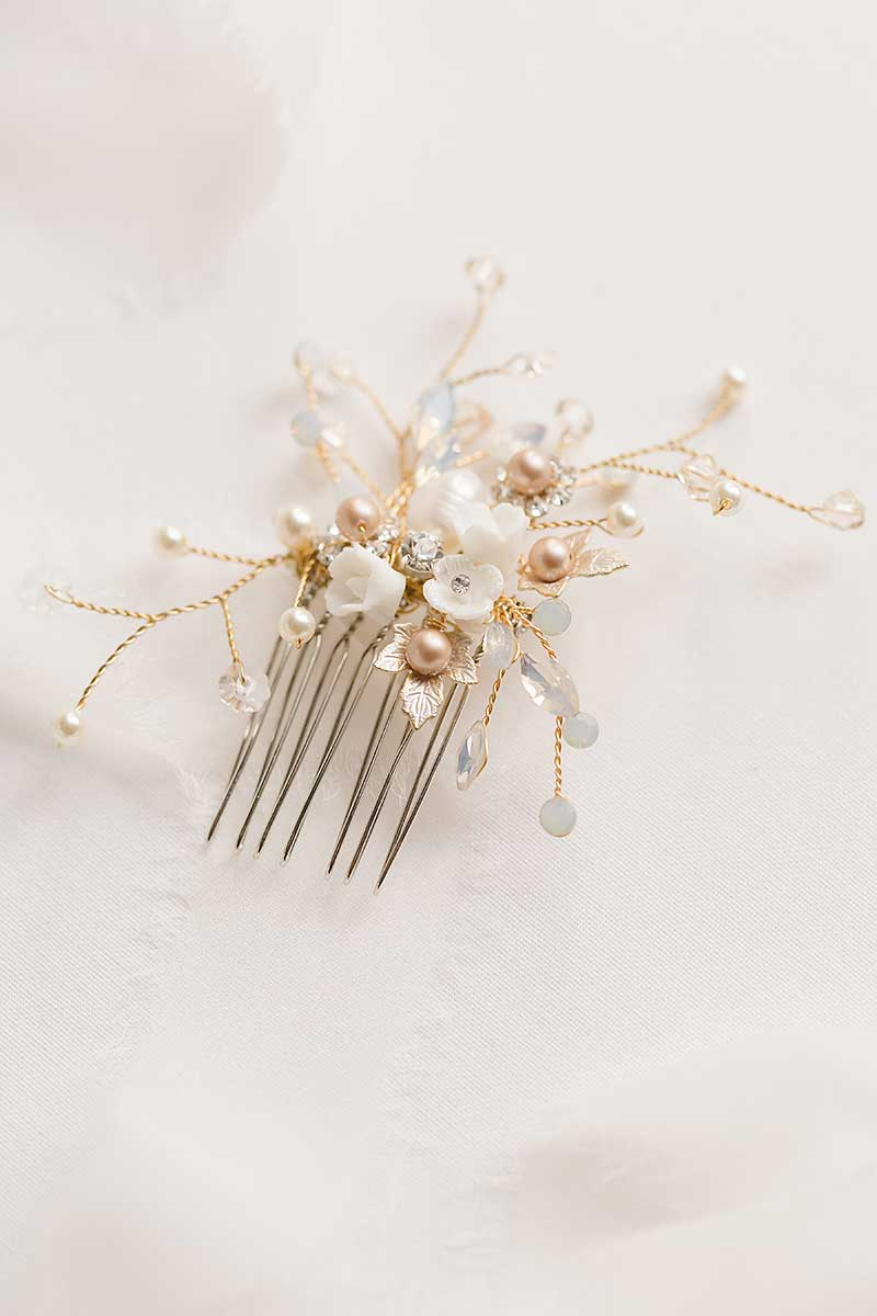 Louise gold wired floral hair comb on white background