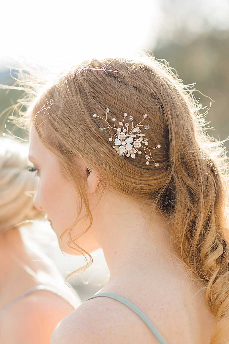 profile of woman wearing small gold flower haircomb