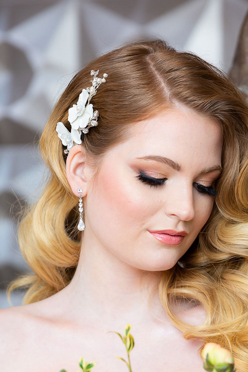 Woman wearing Giordana bridal hair comb tucked at the profile into glam waves