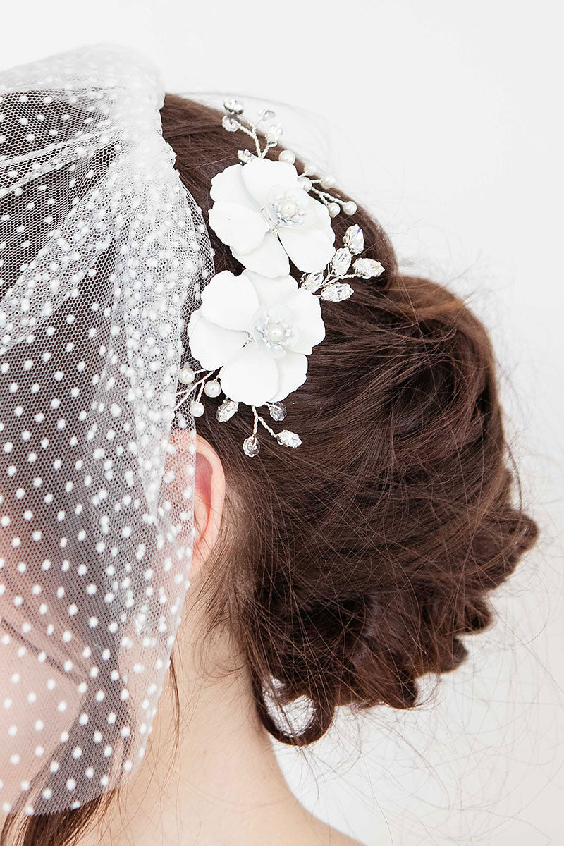 Close up of Giordana floral bridal come in up-do hairstyle