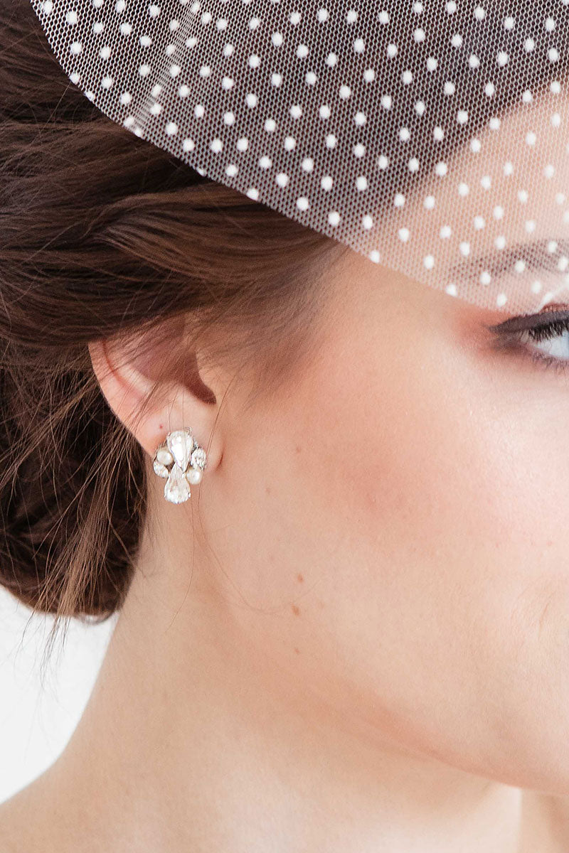 Closeup profile of bride wearing pear crystal and pearl post earrings.