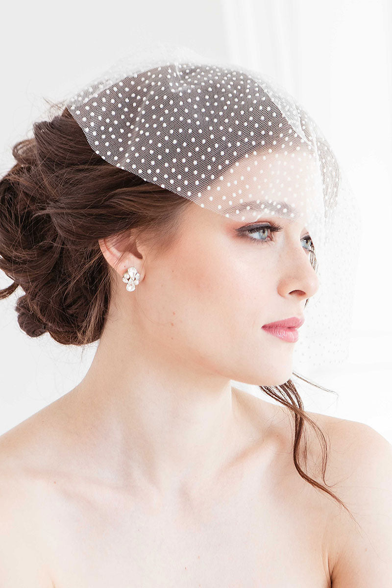 Bride wearing pearl, crystal and silver stud earrings. Bridal jewelry handmade in Canada.