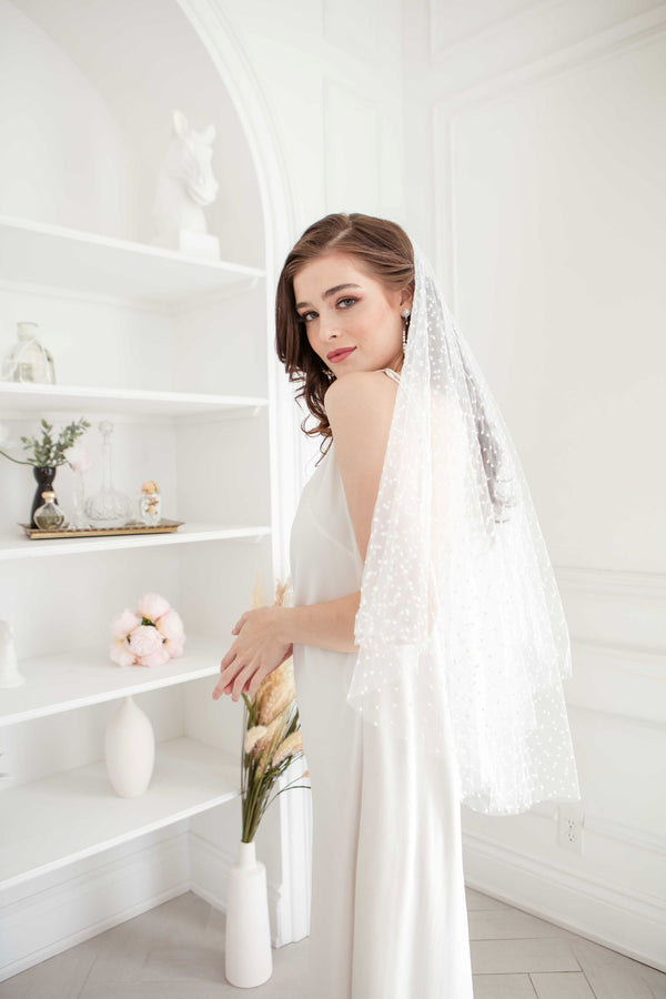 Toronto Bride in fingertip length polka dot veil. Handmade in Canada. Bridal Fashion Trend.
