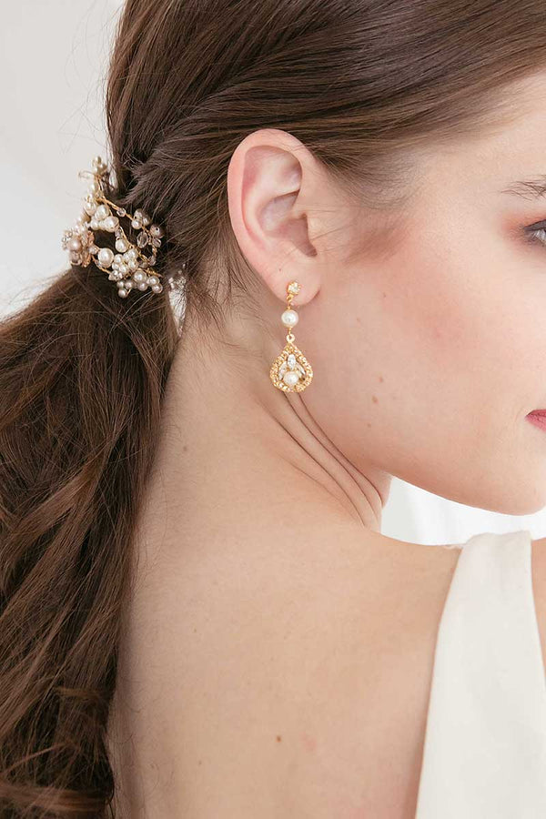 Woman profile with ponytail wrap and gold drop earring