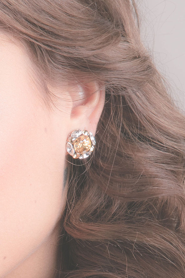 woman wearing cushion cut champagne crystal