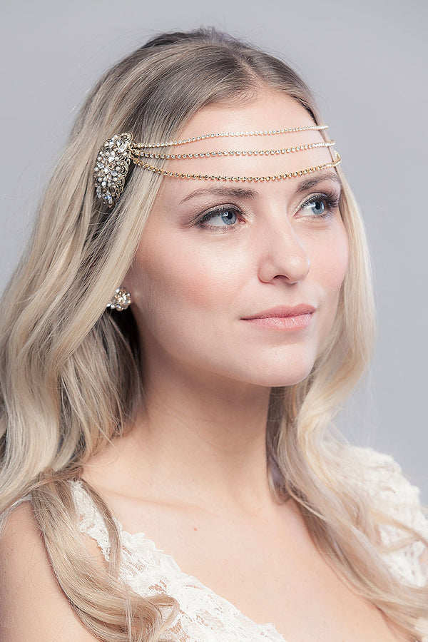 woman wearing draped chain forehead headpiece