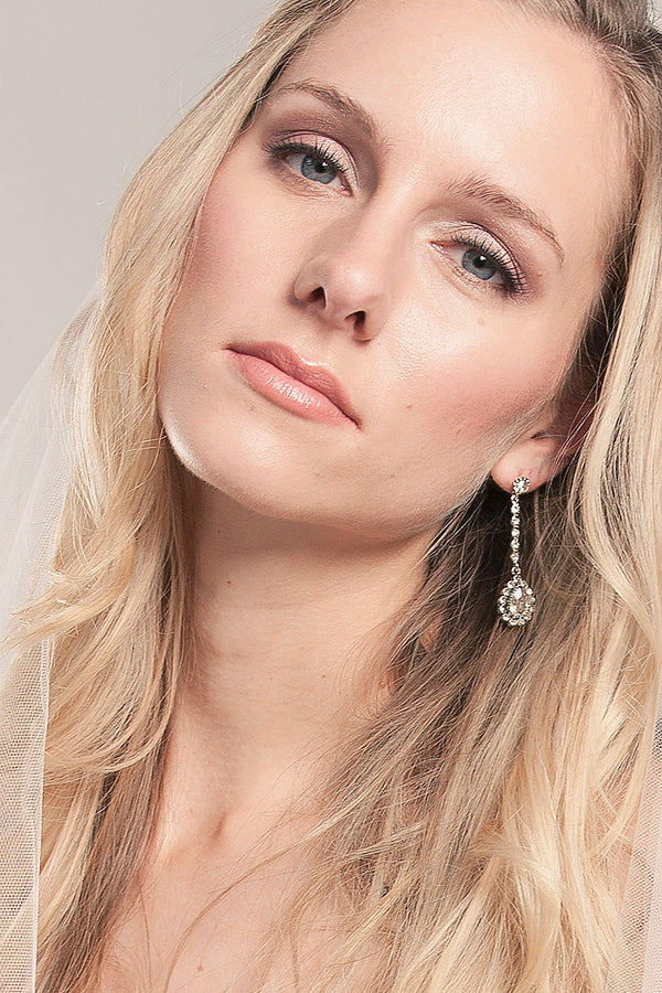 woman wearing crystal pendant pear drop earring