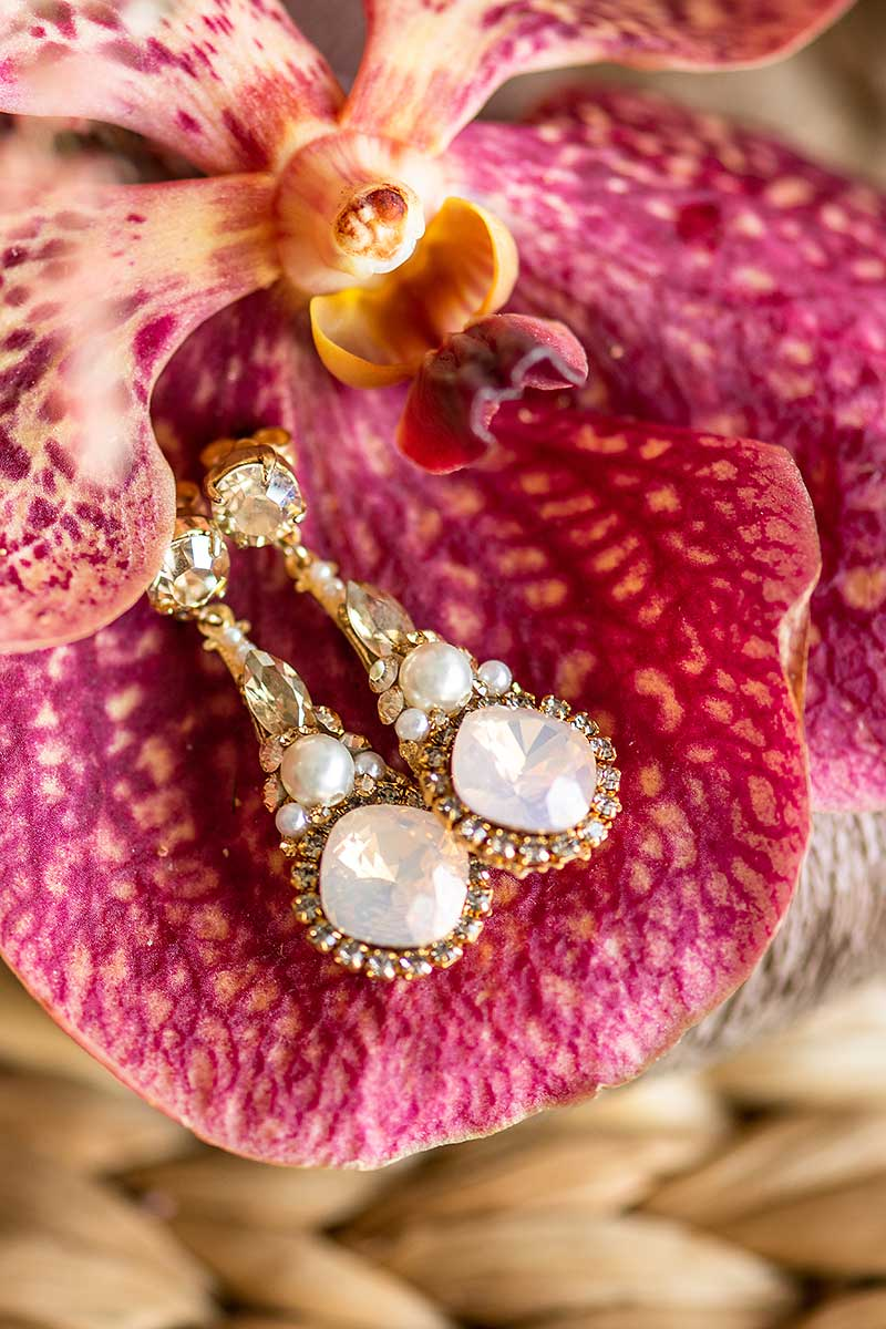 Rose blush crystal and pearl dangle bridal earring. Handmade in Toronto wedding jewelry. Dramatic bridal earring trend. Earrings as featured in wedluxe magazine.