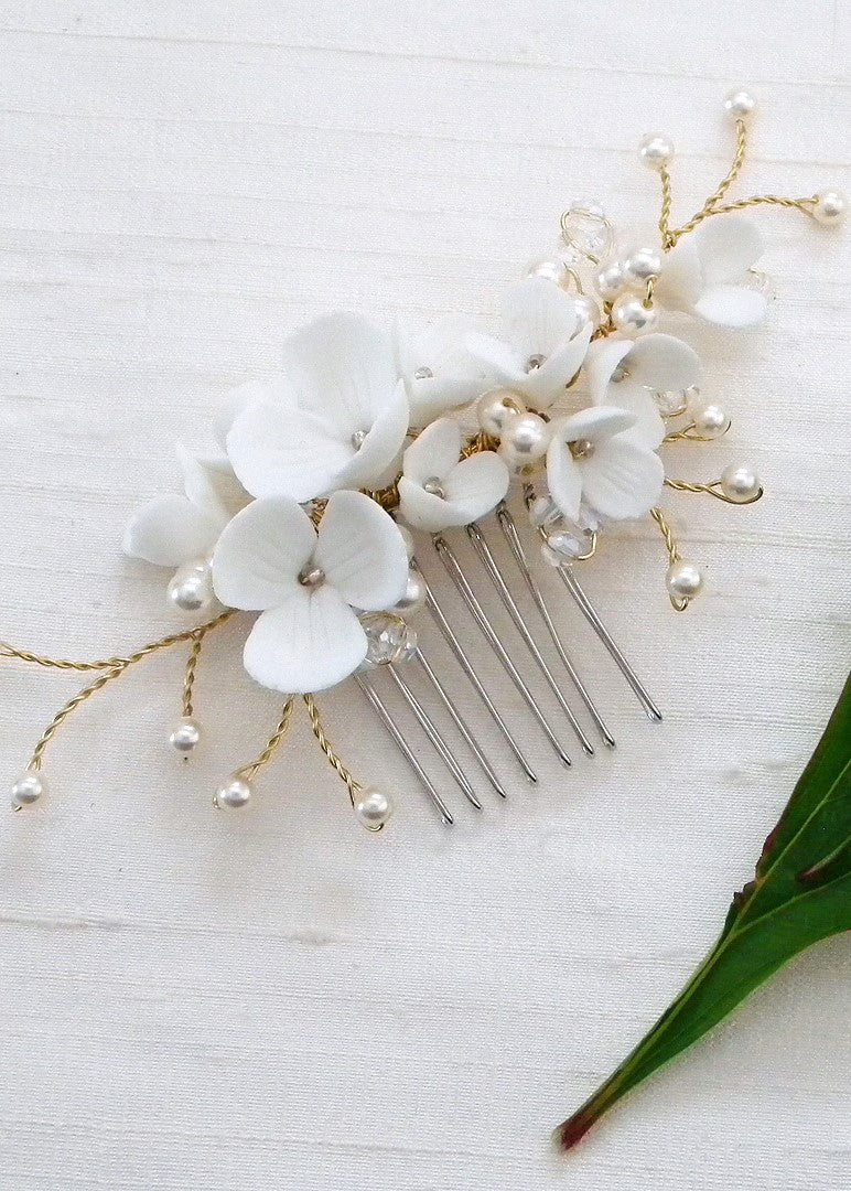 White and gold floral crystal and pearl bridal hair comb accessory.
