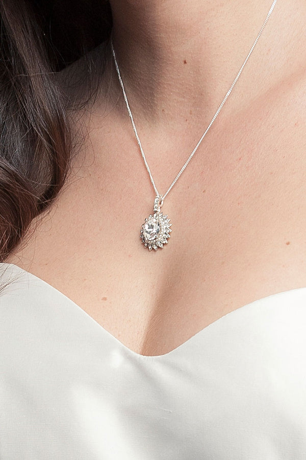 woman's neckline with cystal pendant