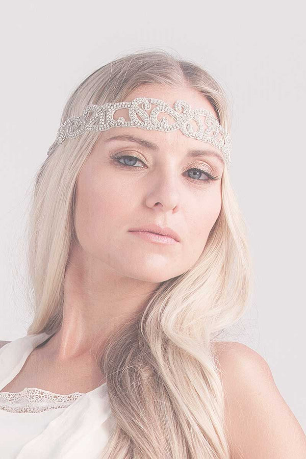 woman wearing crystal headband across forehead