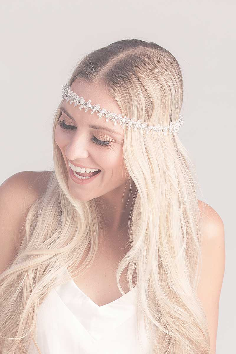 Woman wearing beaded fringe headband across forehead