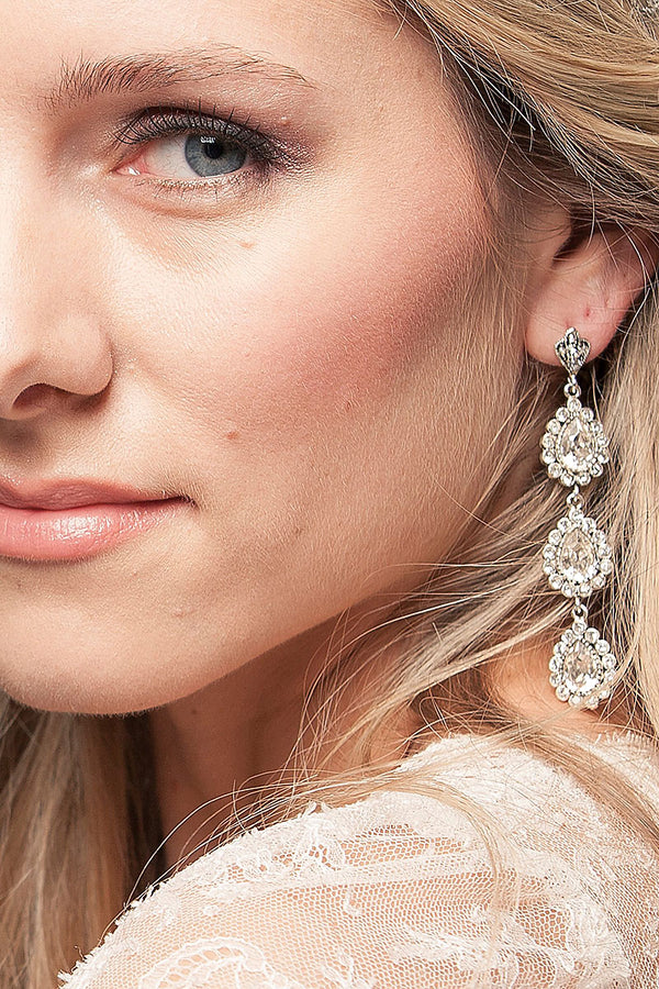 woman wearing crystal drop earrings