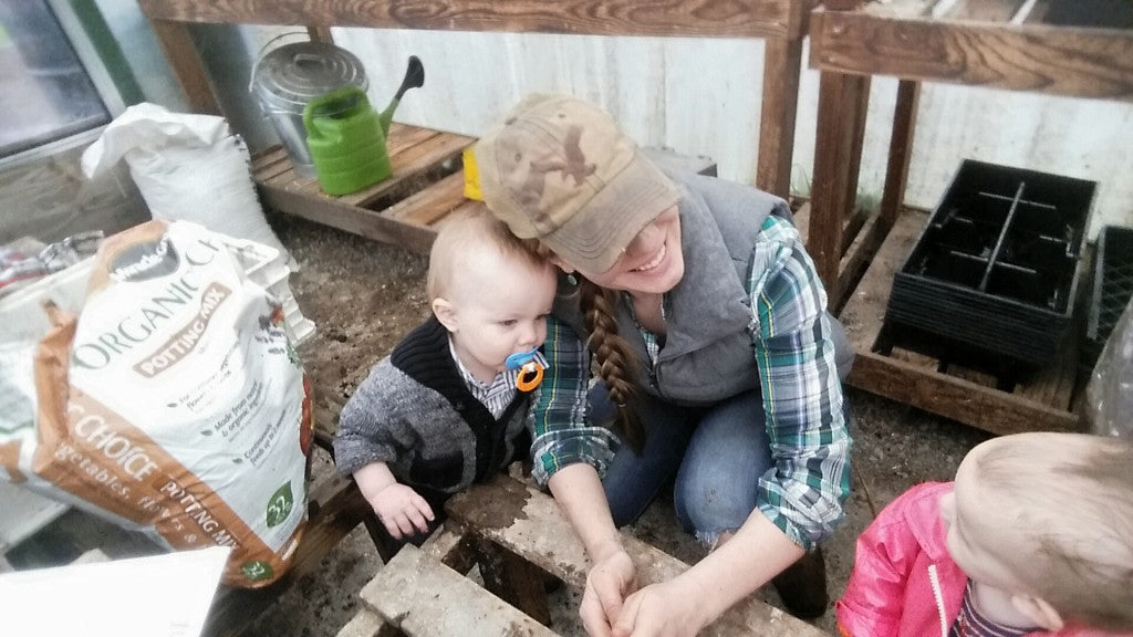 mother and son in the greenhouse at simple goodness farm