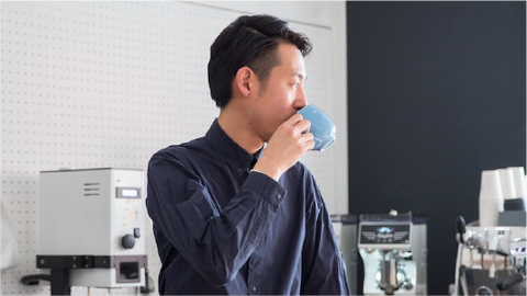 Philocoffea founder and CEO drinking coffee in his coffee shop, Funabashi City, Chiba Prefecture, Japan.