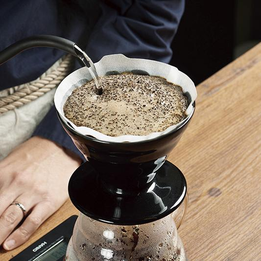 Pouring hot water into a Hario V60 Dripper Kasuya Model