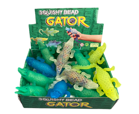 box of toy plastic alligators