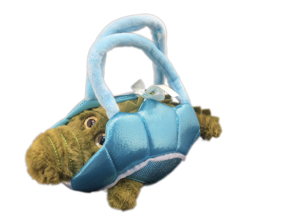 plush alligator toy in blue basket holder