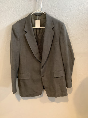 Grey  with two real flap pockets and one hanky pocket on front with two pockets inside. Notch lapel