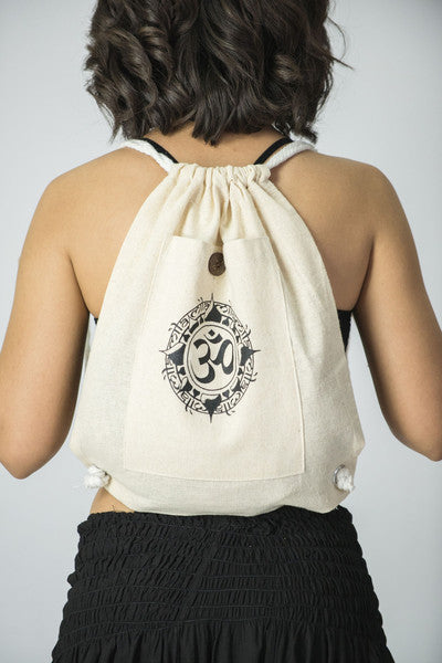 Ohm Drawstring Cotton Canvas Backpack In Cream