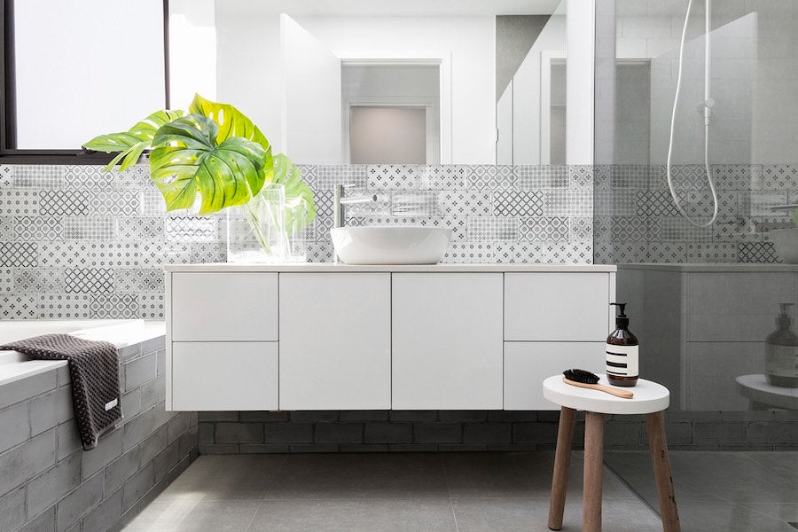 Light Grey Patterned Tiles In The Bathroom