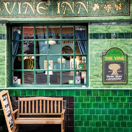 Green Tiles on Front of Pub