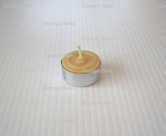 z-tea-light-candle-in-tin-casing.jpg