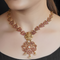Kalyani Gold Plated Pink Floral Necklace With Deity Motif