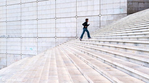 Woman going up steps