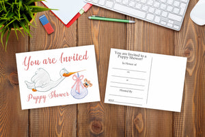 Postcard Invitations for a Puppy Shower Front and Back Sitting on a Desk