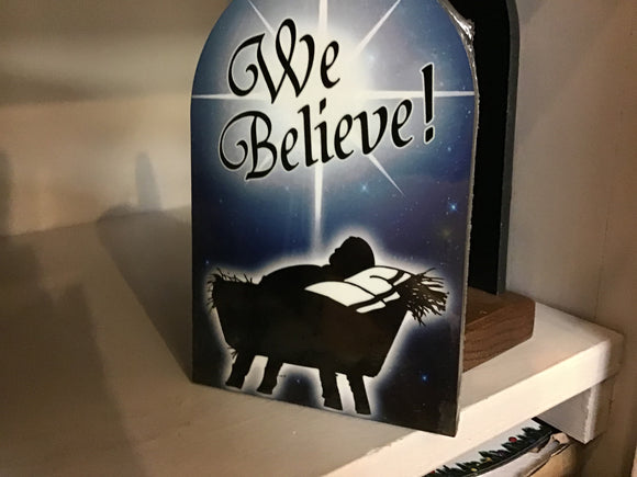 We Believe arched plaque