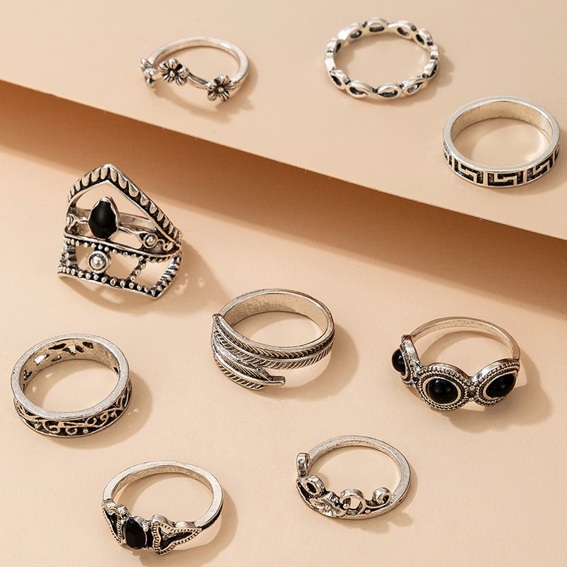 New Retro Hollow Inlaid Black Diamond Flower Leaf Ring 9 Piece Set