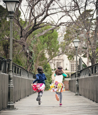 little girls wearing a scrap fabric tutu skirt for toddlers