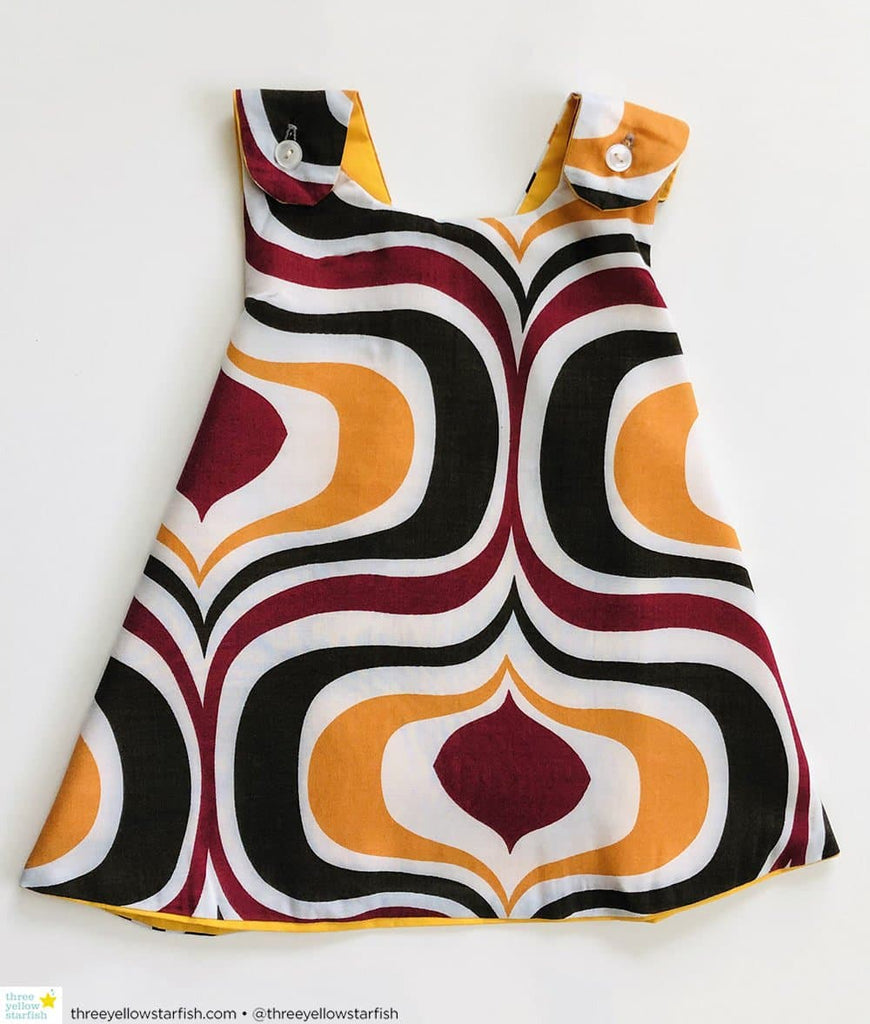 baby girl dress with white and brown swirls