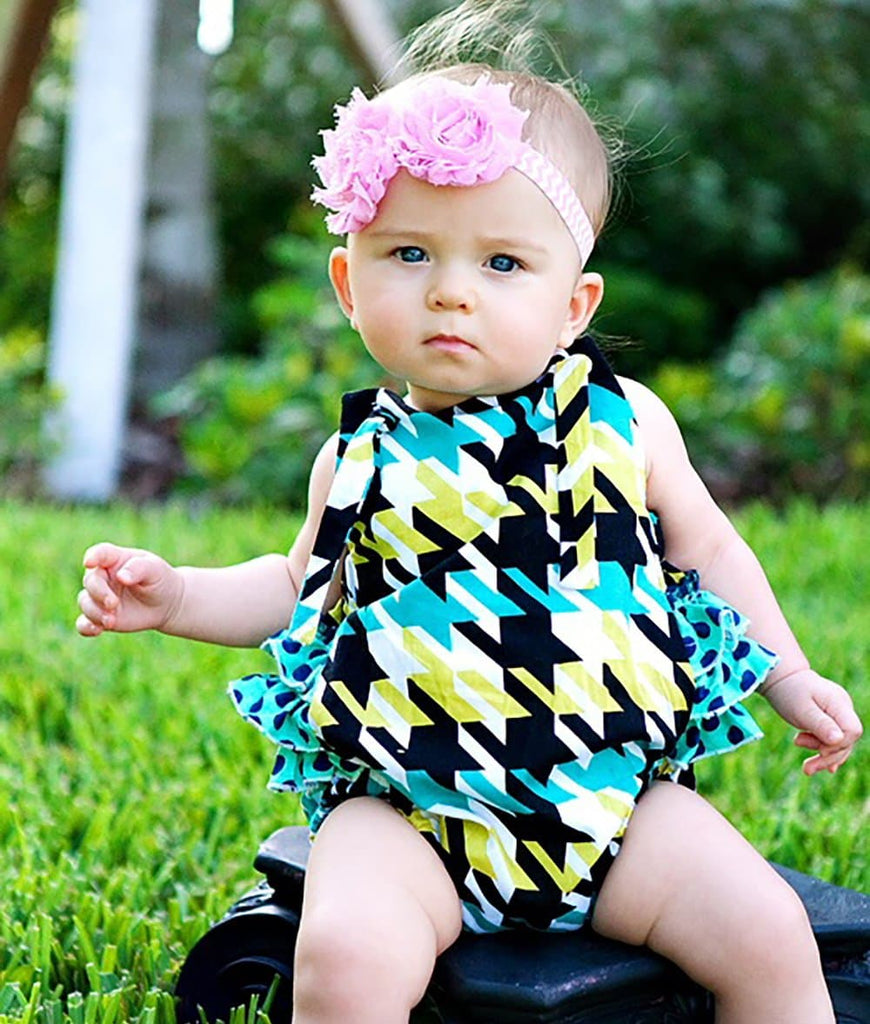 toddler girl wearing a baby romper with ruffles