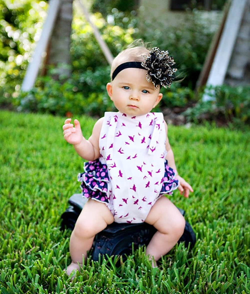 little girl wearing a pink romper for baby and toddlers