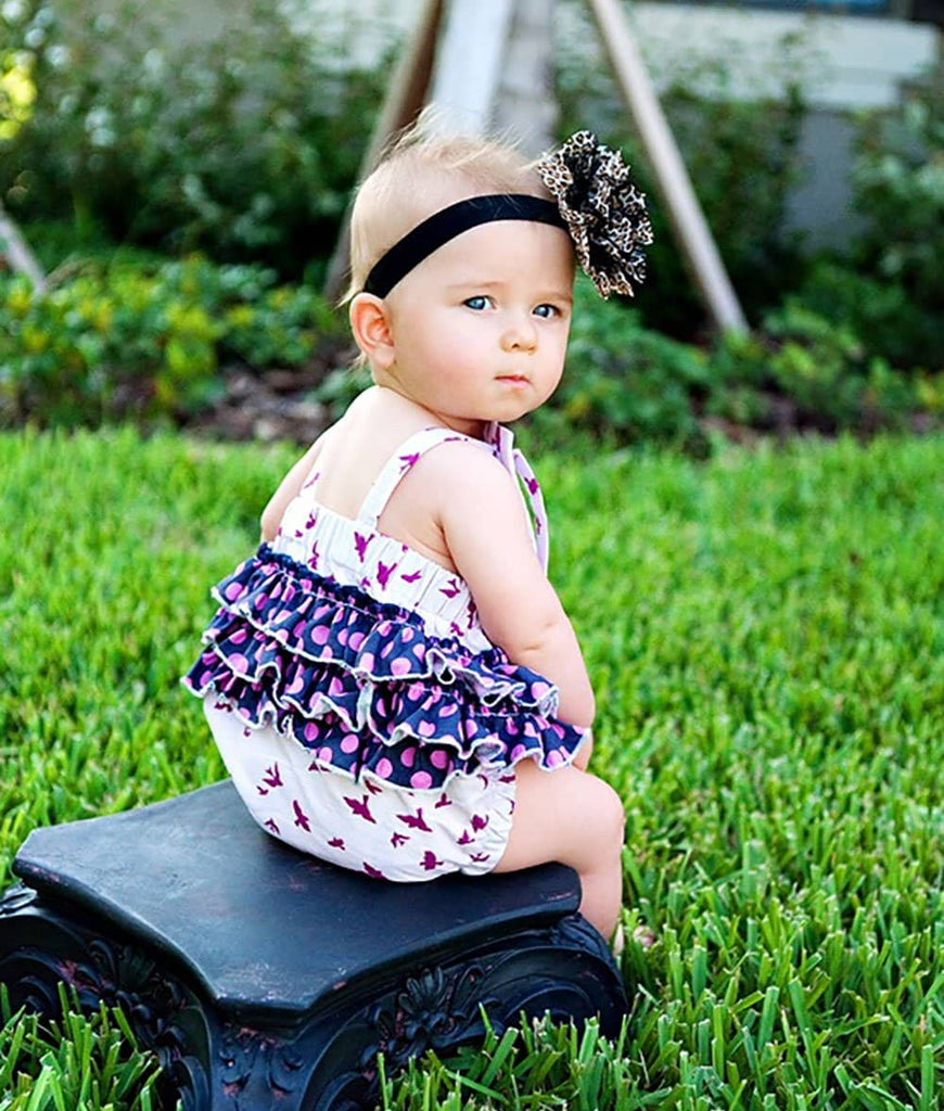little girl wearing pink bird print romper for baby and toddlers