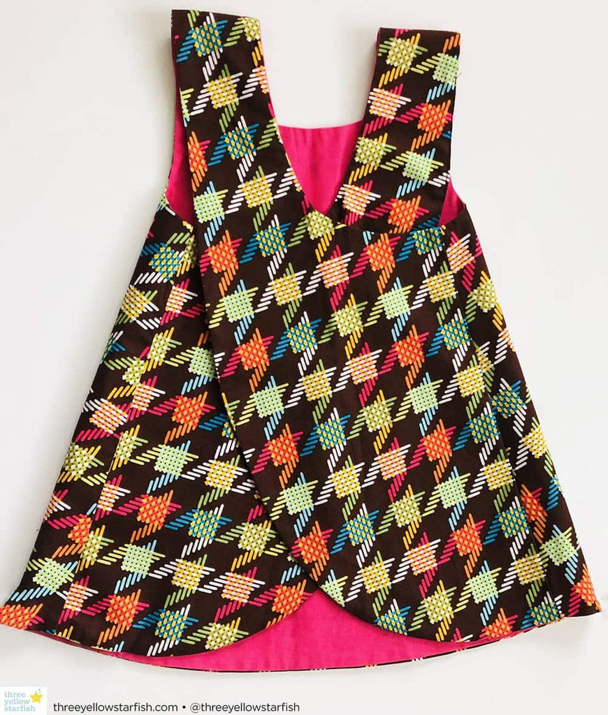 little girl party dress in brown and pink houndstooth print fabric