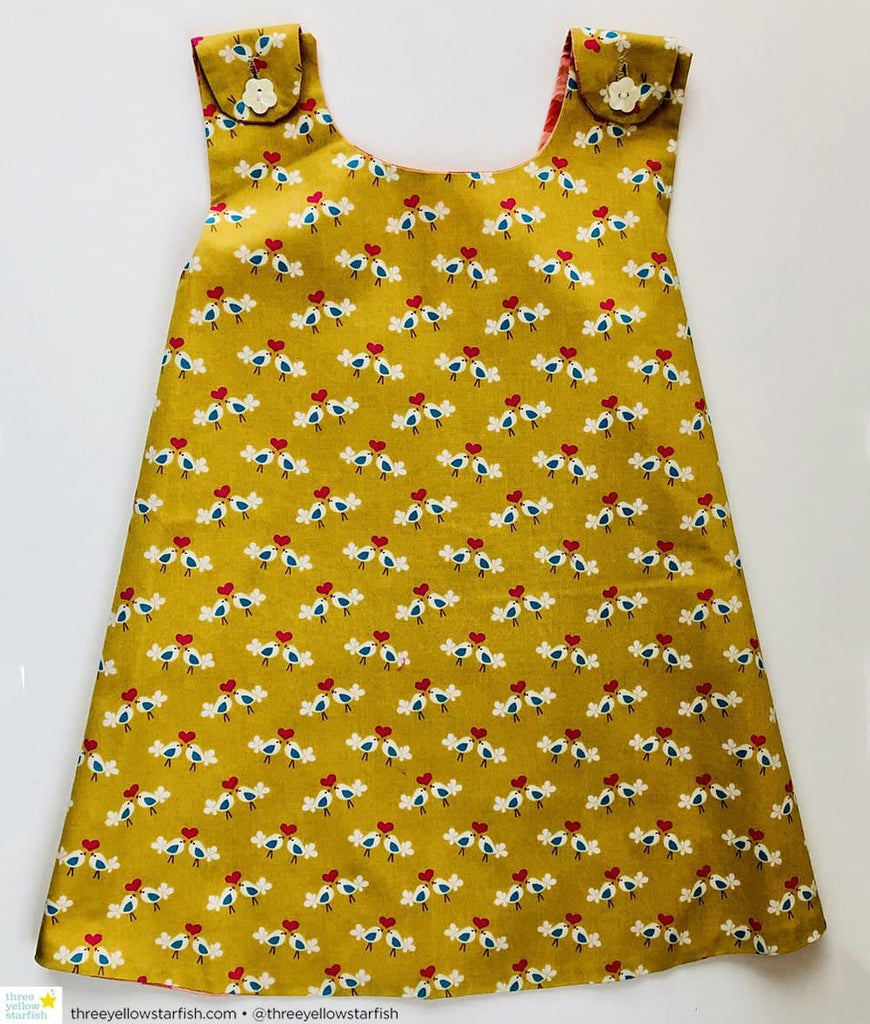 olive green girls dress with bird print fabric