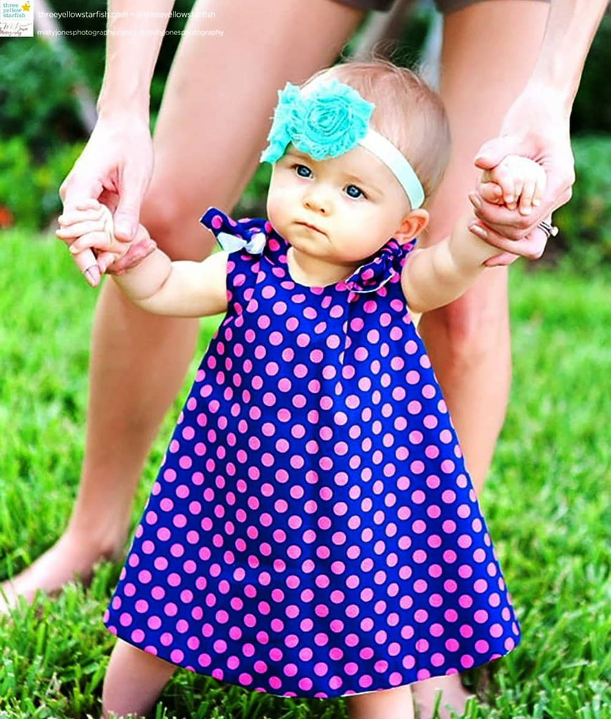 toddler wearing pinafore dress for little girls