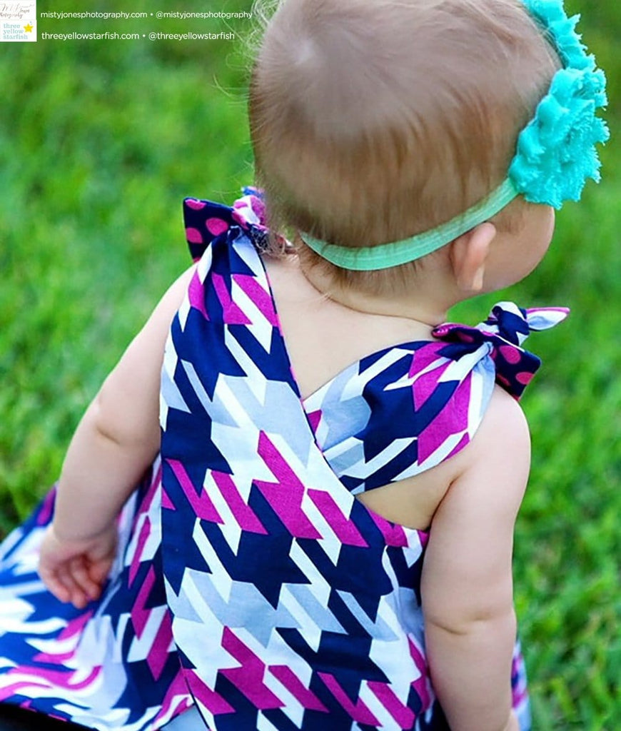 toddler in purple and pink little girl dress