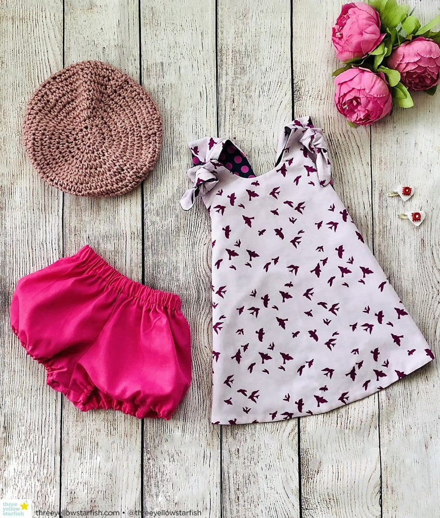 purple baby girl dress with matching toddler hat and baby girl bloomers